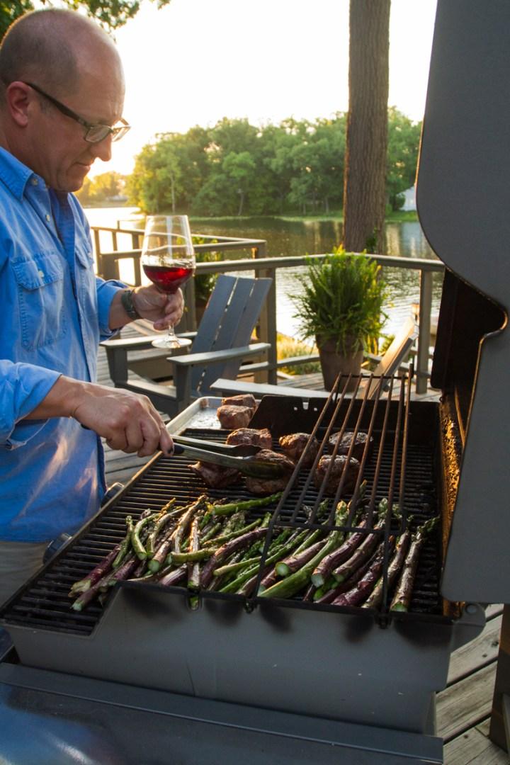 man grilling dinner