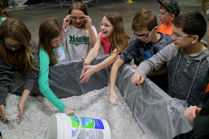 Kids visiting a recycling center
