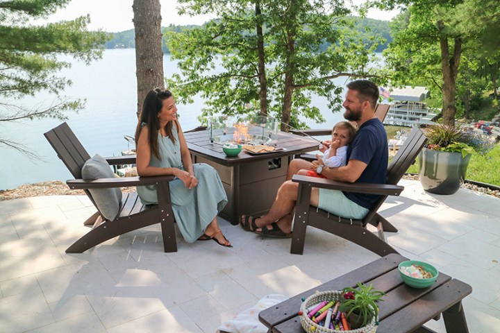 couple and toddler sitting around a polywood fire pit table