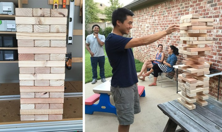 people playing with giant jenga