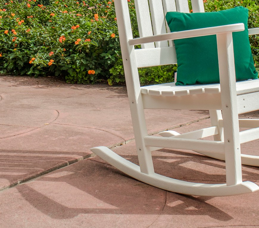 white rocking chair with green pillow