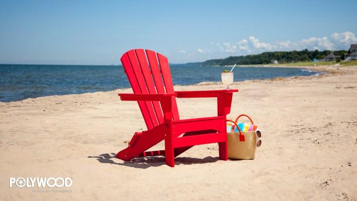red adirondack chair on beach wallpaper