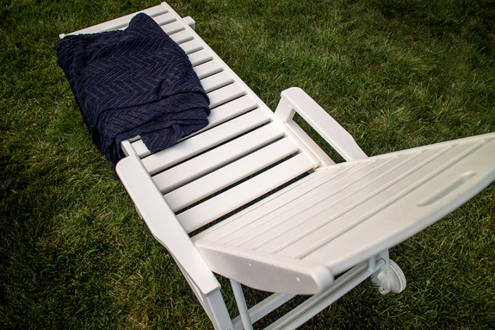 white chaise lounge chair with wheels