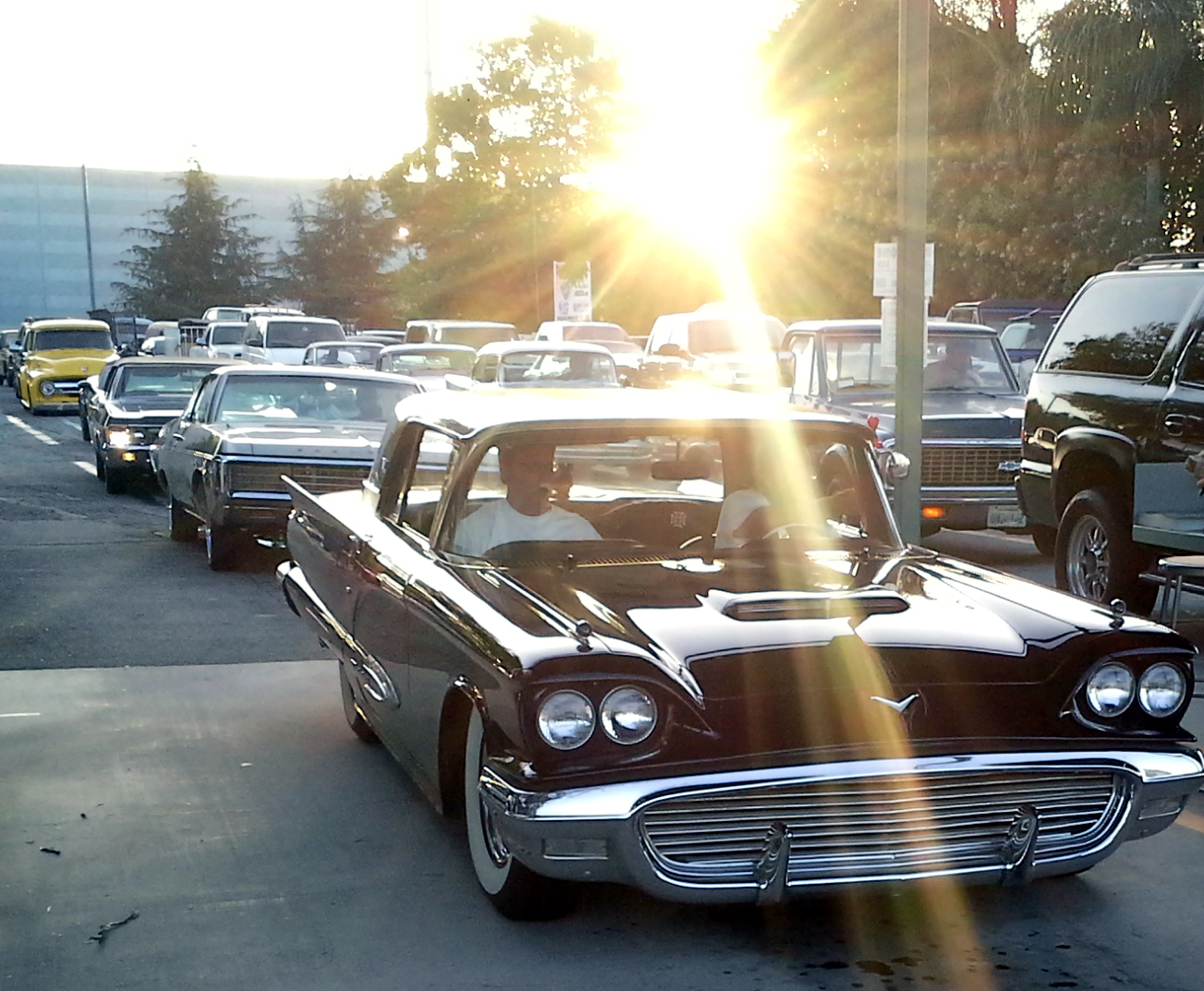 Classic cars entering a recent Pomona Swap Meet... and there's that sun again!
