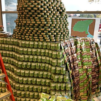 "The Atlanta Canstruction team makes progress on the ""Can Goddess""."