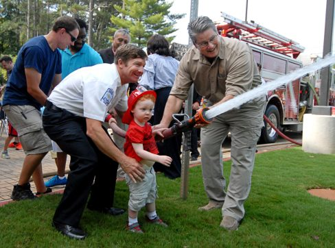 "The community joins in during the ceremonial ""uncoupling of the hose""."