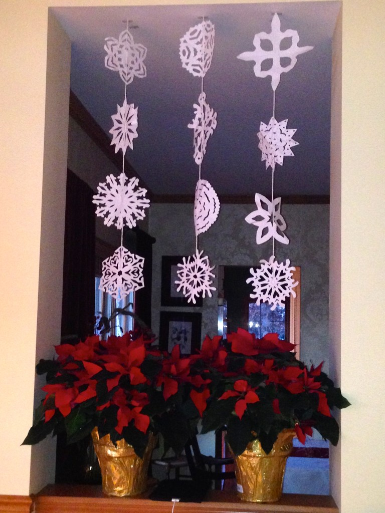 Paper snowflakes and poinsettias