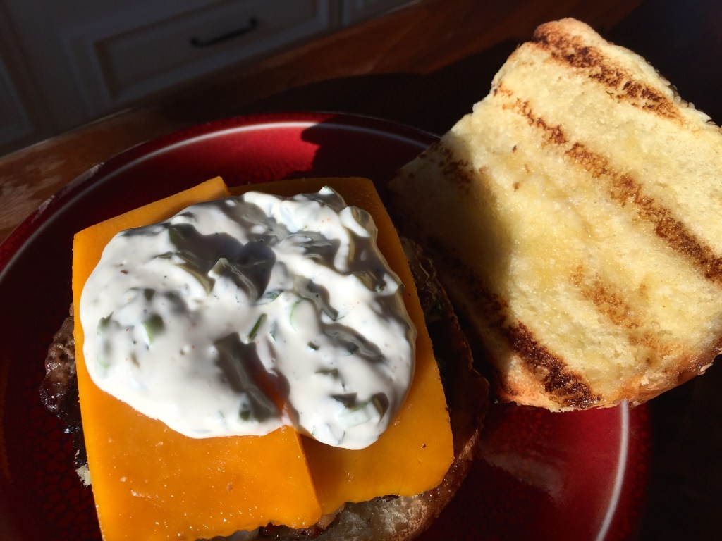 Grilling Season is Here: Jalapeño and bacon cheddar cheeseburgers - adding the delectable ranch sauce