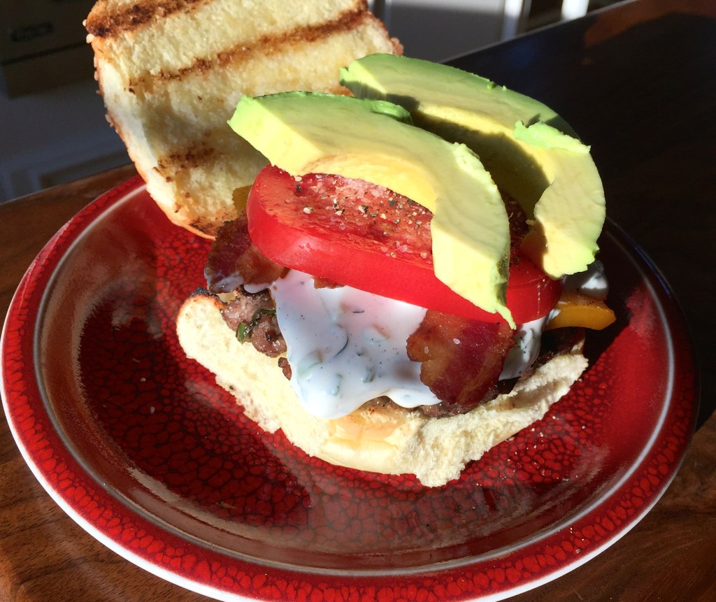 Grilling Season is Here: Jalapeño and bacon cheddar cheeseburgers - stacking on the avocado