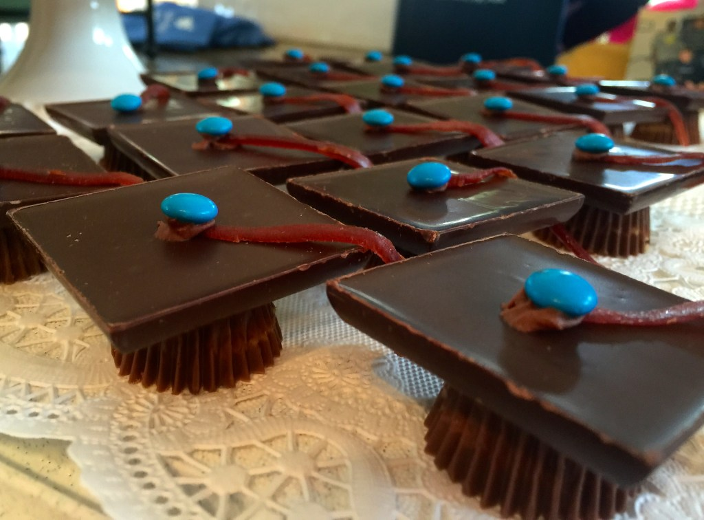Grad party: graduation hats made out of Reese's peanut butter cups and Ghirardelli squares