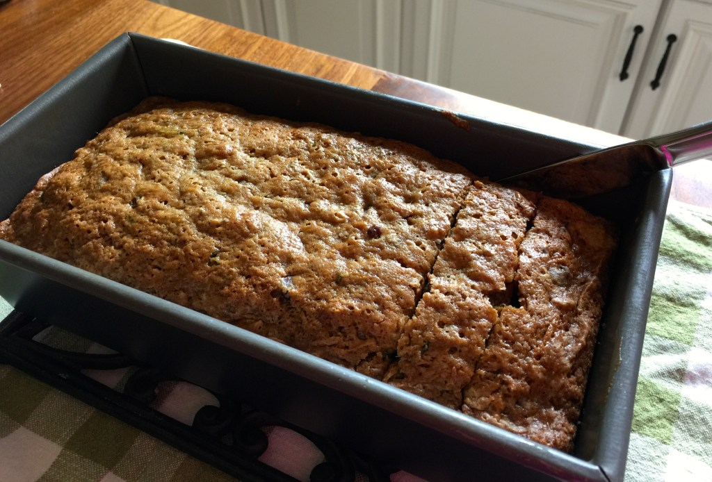 Moist Zucchini bread with chocolate chips: Sliced, warm bread.