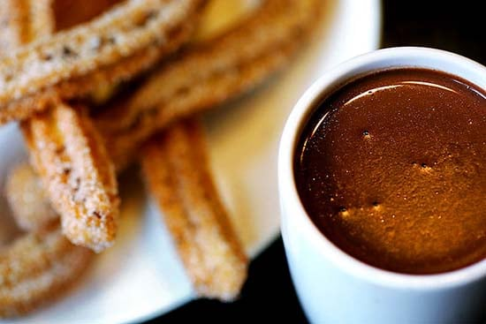 Sally Ryan for The New York Times 11/04/2009 Chicago, Illinois Thick and rich Barcelona hot chocolate is served with homemade churros flecked with bits of chocolate at Xoco, Rick Bayless's new restaurant in Chicago.