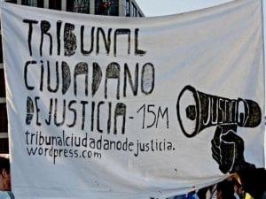 Querella 15M #HazteFiscal contra directivos de Caja Madrid   Tribunal Ciudadano de Justicia 15M   Campaña de crowdfunding en Goteo   Pancarta de la manifestación en la plaza de Castilla de Madrid