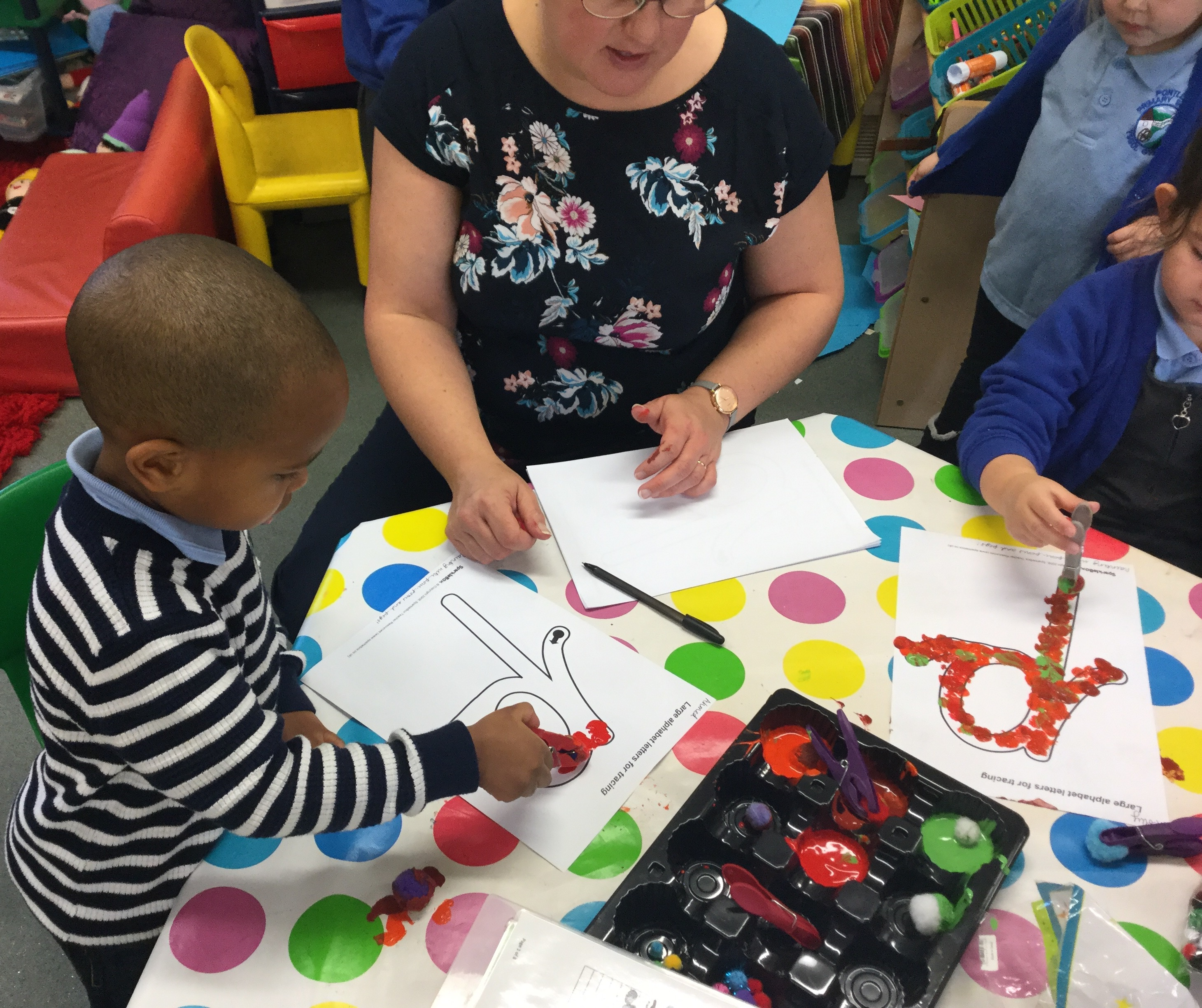 Painting with pegs and pom-poms.