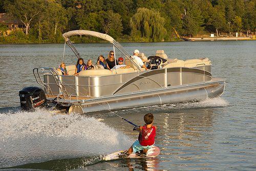 wakeboarding behind a pontoon boat