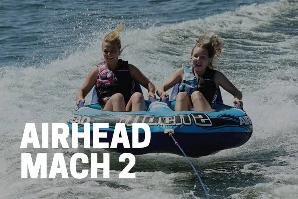 kids and adults riding on an airhead mach 2 towable tube