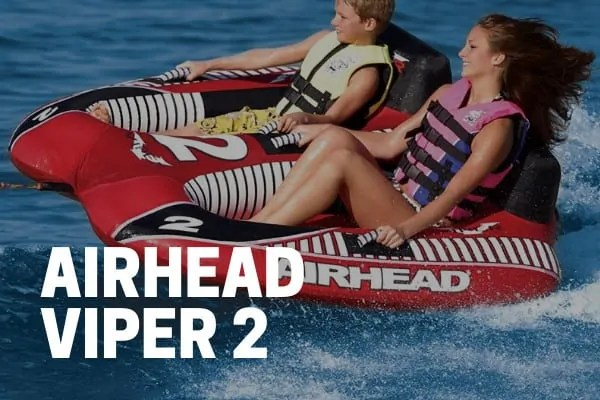 kids and adults riding on an airhead viper 2 towable tube