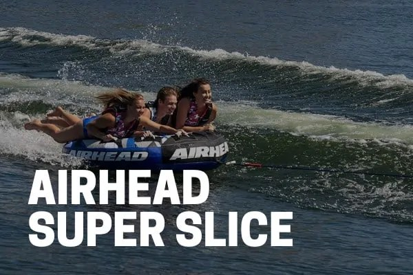 kids and adults riding on an airhead super slice towable tube