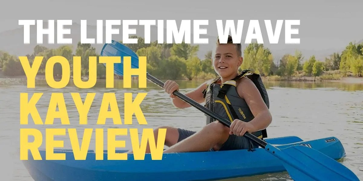 kid riding a lifetime wave youth kayak on a lake