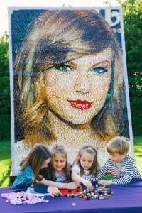 Giant Lego Mosaic of 'Celebrity Best Friend' Taylor Swift revealed at The Legoland Windsor Resort on May 25, 2015 in Windsor, England.  Children helping out to create the mosaic to celebrate the opening of Heartlake City, a brand new LEGO Friends themed area.