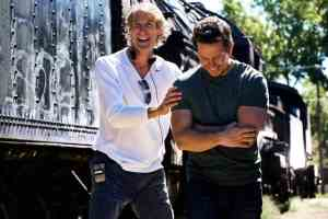 Left to right: Director/Executive Producer Michael Bay with Mark Wahlberg (as Cade Yeager) on the set of TRANSFORMERS: AGE OF EXTINCTION, from Paramount Pictures.