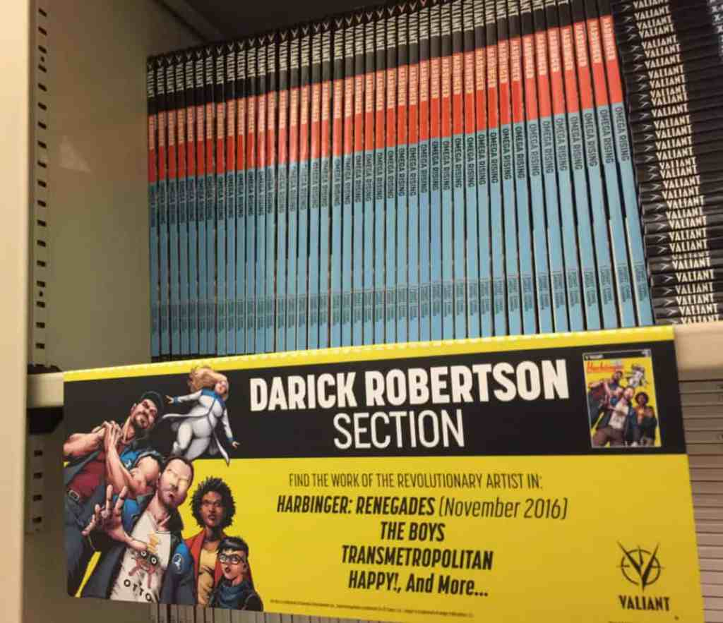 """A """"Darick Robertson Section"""" sign, custom-made to highlight the superstar artist of HARBINGER RENEGADE as well as his other best-selling titles"""