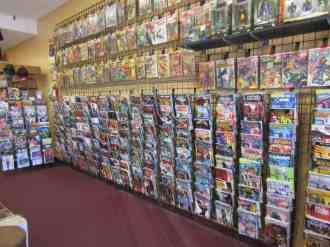 New Release rack w/ older back issues on the wall