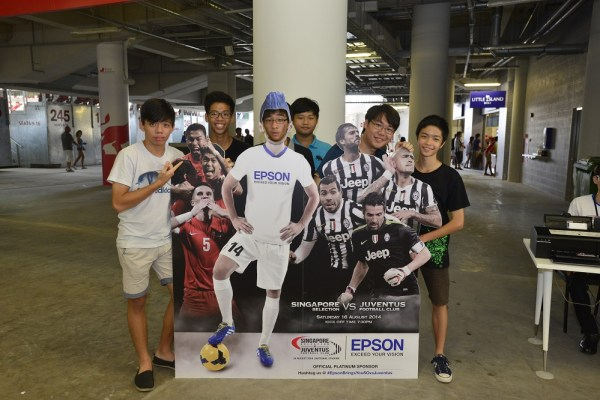 Fans posing at a special Epson photo booth