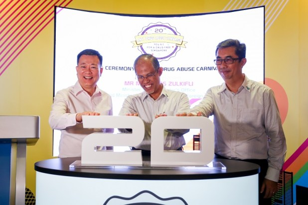 (From Left to Right) Mr Victor Lye, Chairman, National Council Against Drug Abuse, Guest-of-Honour Minister Masagos, Prime Minister's Office and Second Minister for Home Affairs and Foreign Affairs and Mr Ng Ser Song, Director, Central Narcotics Bureau launching the Official Opening of the Anti-Drug Abuse Carnival 2015 | Photo Credits: Central Narcotics Bureau