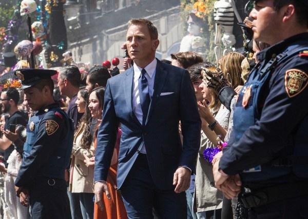 Bond (Daniel Craig) following Marco Sciarra through the Dia de los Muertos procession in Metro-Goldwyn-Mayer Pictures/Columbia Pictures/EON Productions' action adventure SPECTRE.  Tolsa Square, Mexico City.