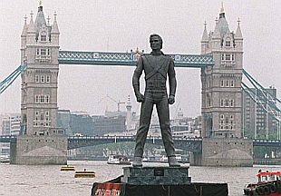 One of Michael Jackson's 9 'HIStory' promo statues being floated  on the Thames River in London, June 1995.