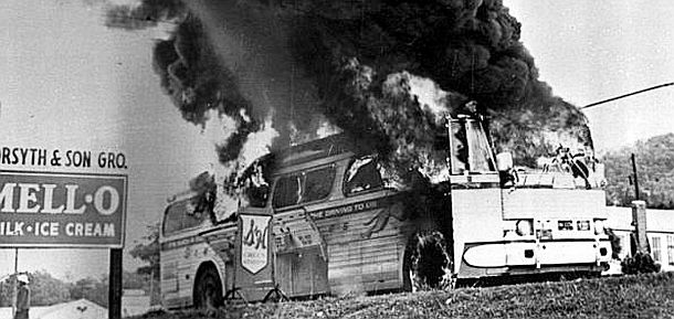 Mothers' Day, May 14, 1961, as Greyhound bus carrying Freedom Riders and other passengers burns after being fire-bombed by white mob that attacked the bus and some riders near Anniston, Alabama.