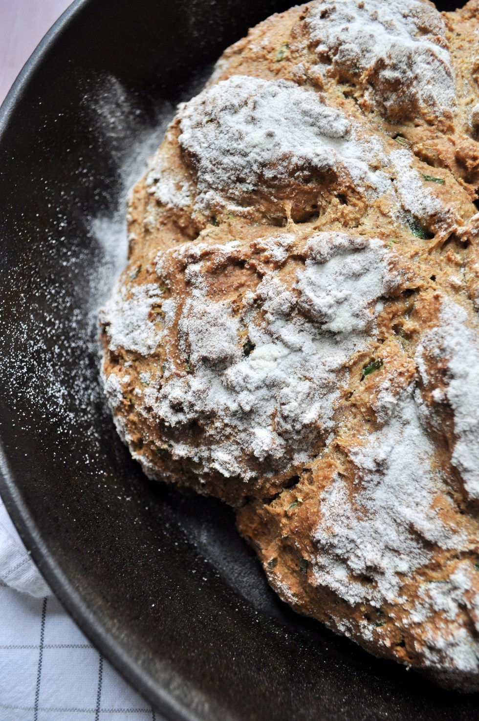 A hearty multigrain irish soda bread chalked full of green chives (instead of food coloring) and perfect with a pat of butter.