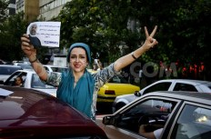 1371604191-iranians-celebrate-their-success-on-going-to-brazil-world-cup-2014_2170291