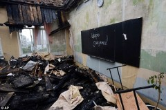 1409261596610_wps_4_A_school_damaged_by_shell