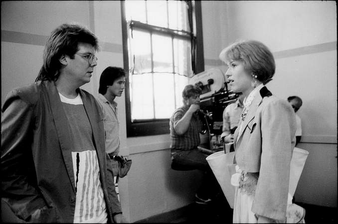 Hughes and Ringwald talk on the set of 'Pretty in Pink.'