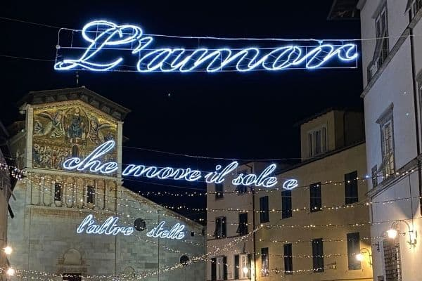 Holiday lights in Lucca with writing in Italian