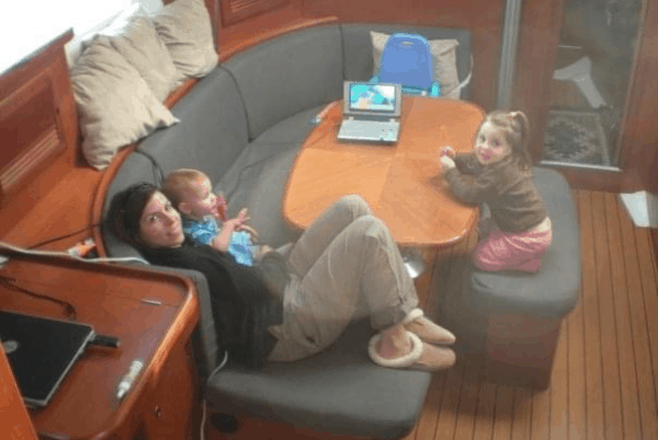 The author and two young children in the salon of their 39 ft boat