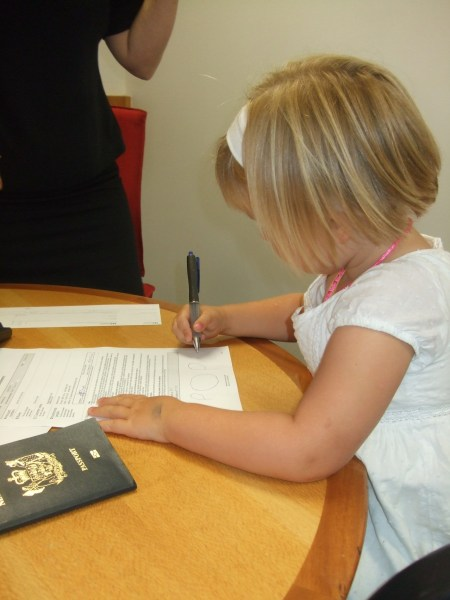 Signing her name on the paperwork