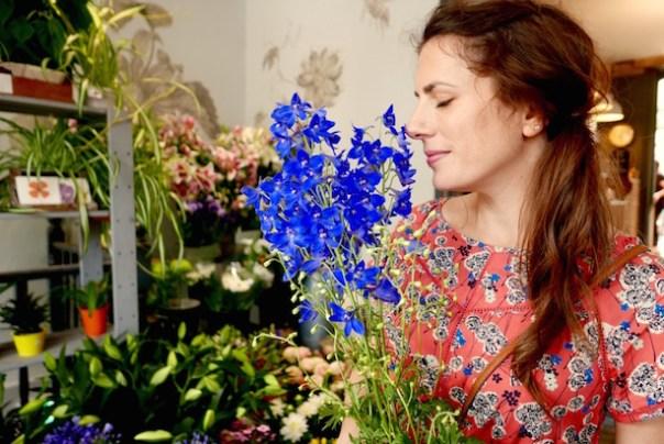 Poppy Loves smelling flowers