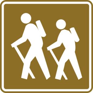 Image of hikers crossing sign
