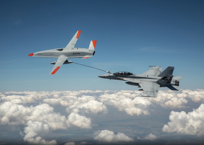 Watch a fighter jet and drone make 'wet contact' for the first time.