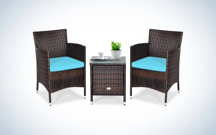 wicker patio furniture set with blue cushions