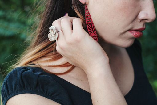 Val wearing potions gemstone rings and laser cut leather earrings   handmade jewelry at Pop Shop America from the Hallows Look Book   Shop Online Now