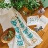 tea cups & gold ivy tea towel lifestyle photo pop shop america