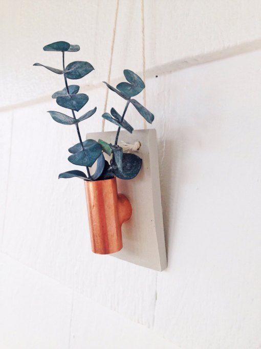 side-view-of-taller-copper-and-concrete-planter