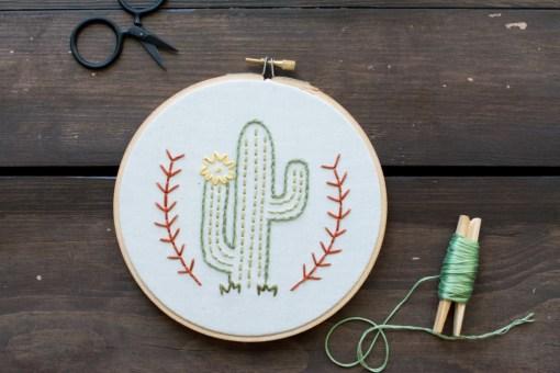 detail of flowering desert cactus embroidery hoop art