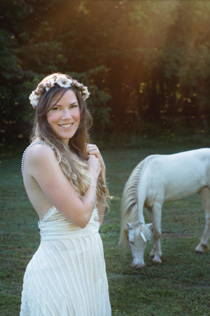 brittany unicorn photo with white dress close up