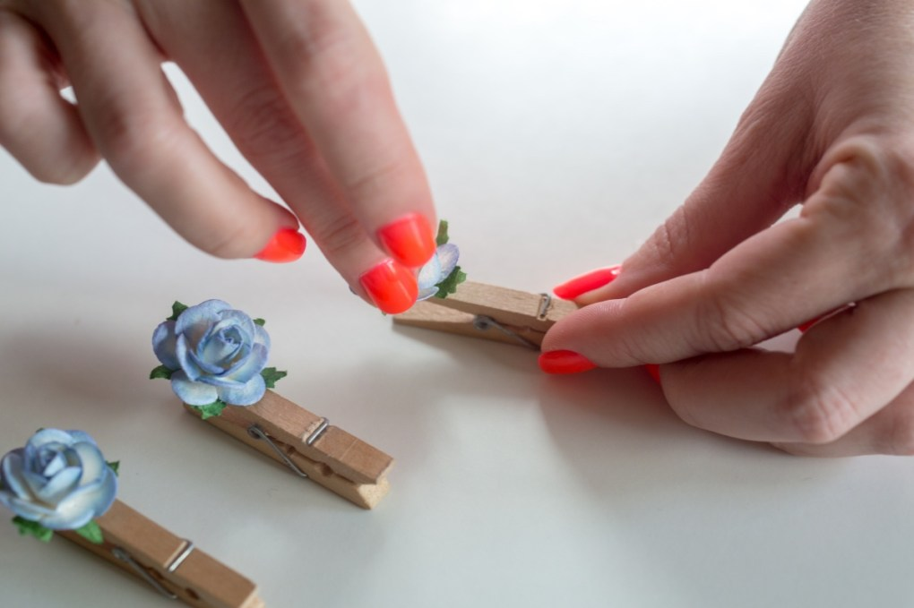press the flowers in the hot glue diy clothespins with flowers