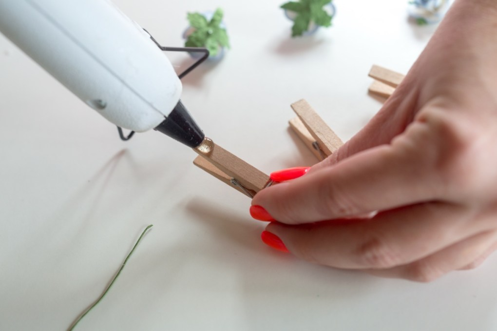 use a drop of hot glue to make diy flower clothespins